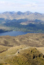 The cobbler tarbet loch lomond from ben lomond view north west summit of past walkers on path up to summit looking across to and Royalty Free Stock Photography