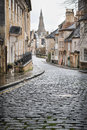Cobbles yellow line on a cobbled street in the town of stamford england where most houses are stone built and date from the Stock Image