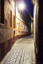 Cobblestone alley empty pedestrian in city at night Stock Photography