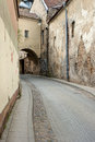 Cobblestone curve road narrow street in the old public domain european city Royalty Free Stock Images