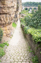 Cobblestone path in luxembourg s grund valley Royalty Free Stock Image