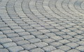 Cobblestone pavement background circle paving Royalty Free Stock Photos