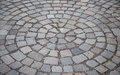 Cobblestone pavement with circular pattern Royalty Free Stock Photography