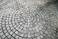A cobblestone road - circle pattern Royalty Free Stock Photo