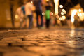 Cobblestone road at night Royalty Free Stock Photo
