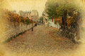 Cobblestone road in Paris in vintage style Royalty Free Stock Photos