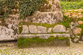 Cobblestone road to the palace foam among the rocks and trees an Royalty Free Stock Photo