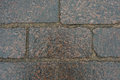Cobblestone road with wet slippery surface. Royalty Free Stock Photo