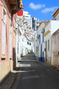 Cobblestone street in albufeira portugal narrow old town showing condos the background algarve Stock Image