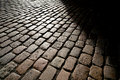 Cobblestones in backlight at sunset Royalty Free Stock Image