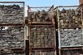 Cobblestones in baskets sorted by size wire a demolition company Royalty Free Stock Image