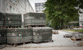 Cobblestones on pallets. Road repairs of apartment houses in the