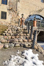 Cobbly staircase railings retro manor snow remain stone with steel and light lamp leading to and in spring Royalty Free Stock Photography