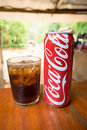 Coca-Cola can drink and a glass of coke with ice cubes Royalty Free Stock Photo