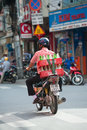 Coca cola delivery man ho chi minh vietnam july an unidentified rides a motor bike carrying a box with empty bottles of and sprite Royalty Free Stock Image
