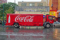 Coca cola delivery truck stopping by the roadside in new york city on a rainy day produced company of Royalty Free Stock Image