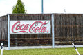 Coca cola fürstenfeldbruck sign infront of a bottling plant in germany the sign is really that bleached out Stock Image