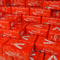 Coca cola friends a pallet with packs of shrink wrapped coke cans Royalty Free Stock Photography