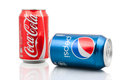 Coca cola and pepsi cans on white background Stock Photography