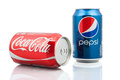 Coca cola and pepsi cans on white background symbolic representation of one of the greatest business rivalries Royalty Free Stock Photos