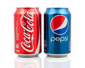 Coca cola and pepsi cans on white background symbolic representation of one of the greatest business rivalries of all time Royalty Free Stock Photo