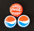 Coca Cola and Pepsi Cola Bottle Caps Royalty Free Stock Photo