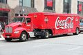 Coca cola truck chicago june people walk past on june in chicago company is a beverage company with usd billion in Royalty Free Stock Images