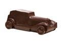 Coche retro hecho del chocolate oscuro Fotografía de archivo