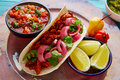 Cochinita Pibil Mexican food with pico de gallo Royalty Free Stock Photo