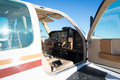 Cockpit of small white propeller aircraft plane Royalty Free Stock Photo