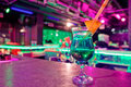 Cocktail at bar in a night club with vivid colors Stock Images