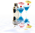 Cocktail with blue curacao & shaker with reflection on water Royalty Free Stock Photo