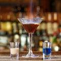 Cocktail with a burning sambuca Royalty Free Stock Photo