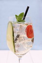 Cocktail with cucumber strawberry in wine glass close up Stock Images