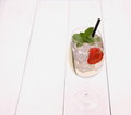 Cocktail with cucumber strawberry in wine glass horizontal Royalty Free Stock Images