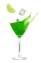 Cocktail drink splash ice cube and lime falling into a glass Royalty Free Stock Image