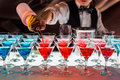 Cocktail drinks on a bar,shot glasses being poured Stock Photography