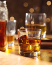 Cocktail glass of whiskey on wood bar Royalty Free Stock Photo