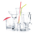 Cocktail glasses with drinking straws and umbrella Royalty Free Stock Photo