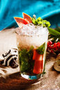 Cocktail with grapefruit and mint cup of ice chips still life on the sand summer drink Royalty Free Stock Photo