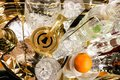 Cocktail hour - martini shaker on tray with various crystal glasses and bottles and an orange - top view and selective focus Royalty Free Stock Photo