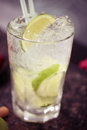 Cocktail with lime and ice Royalty Free Stock Photo