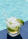 Cocktail Majito on edge by poolside Royalty Free Stock Photo