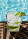 Cocktail Majito on edge by poolside Royalty Free Stock Image