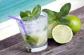 Cocktail mojito ice lemon straws in tropical beach Islands again Royalty Free Stock Photo