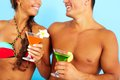 Cocktail party close up of cute girl and handsome men with cocktails at beach Royalty Free Stock Photos
