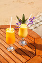 Cocktail pineapple mango passion fruit juice ice table Royalty Free Stock Photo
