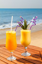 Cocktail pineapple mango passion fruit juice ice table Royalty Free Stock Images