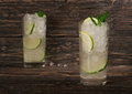 Cocktail with rum in tall glass with ice, lime, mint Royalty Free Stock Photo
