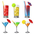 Cocktail set with different colored drinks umbrellas and straws Royalty Free Stock Image